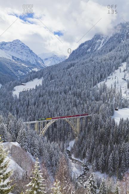 Rhaetian railway passing through Langwieser Viaduct bridge, Switzerland