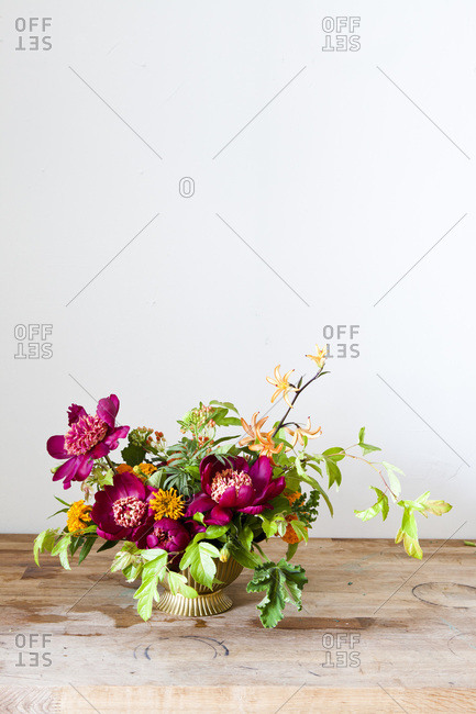 Flower arrangement on wooden surface