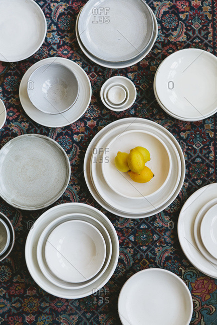 Lemons and ceramic plates in various sizes