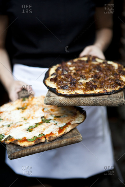 Pizzas baked in a wood-fired oven