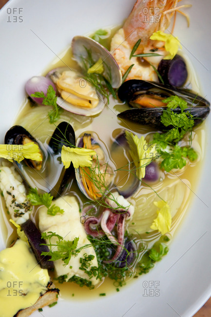 Soup with fresh mussels, shrimp and squid