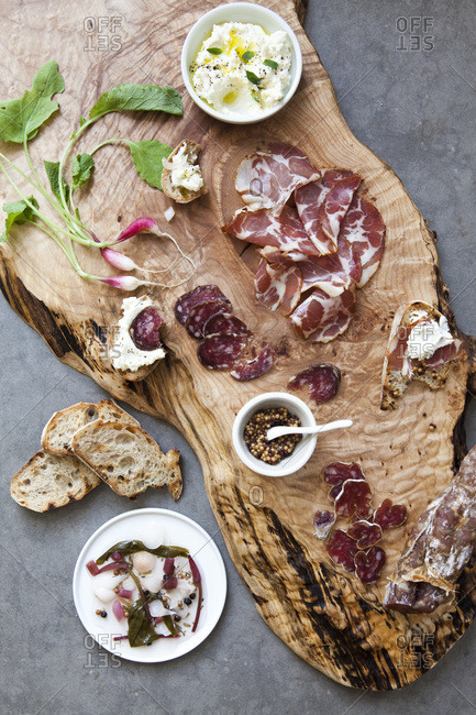 Charcuterie board with pickled ramps