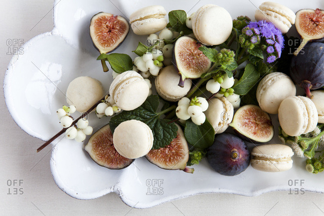 Overhead view of macaroon and figs on plate