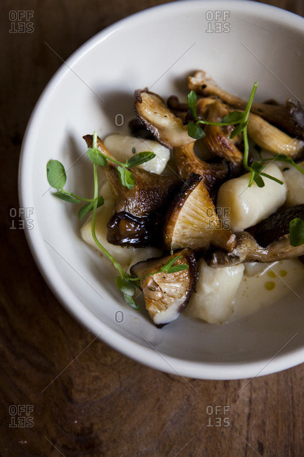 Overhead view of gnocchi with wild mushrooms