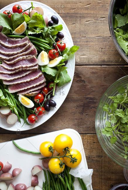 Overhead view of medium rare tuna and green salad