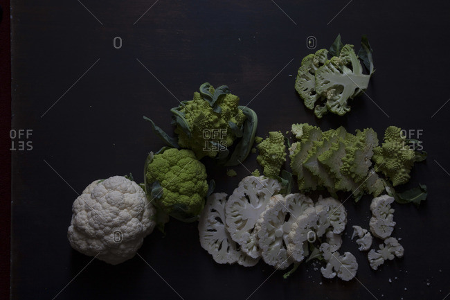 Three different raw cauliflowers thinly sliced up