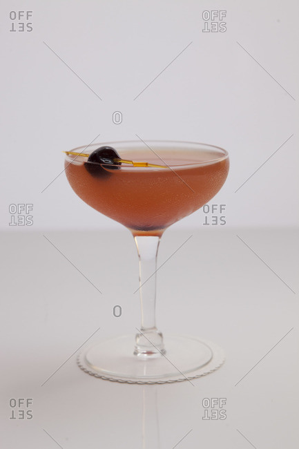 Infamous Wisdom cocktail served in champagne saucer