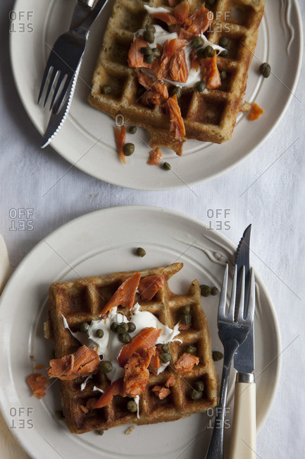 Millet waffles with smoked salmon, creme fraiche, and capers