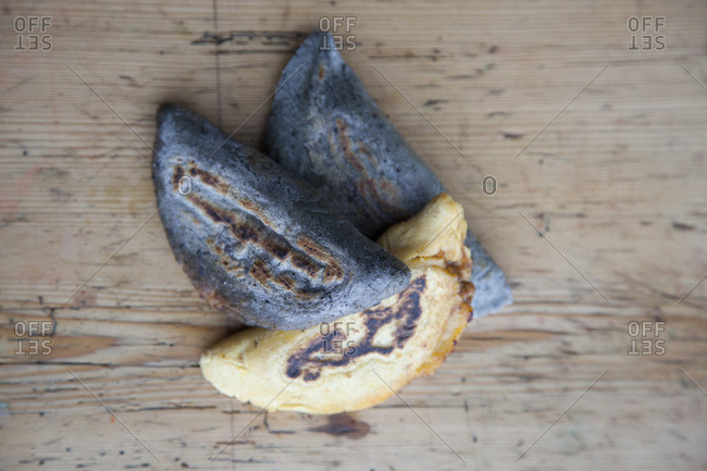 Top view of blue corn and common empanadas