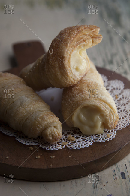 Close-up of pastry roll with whipped cream