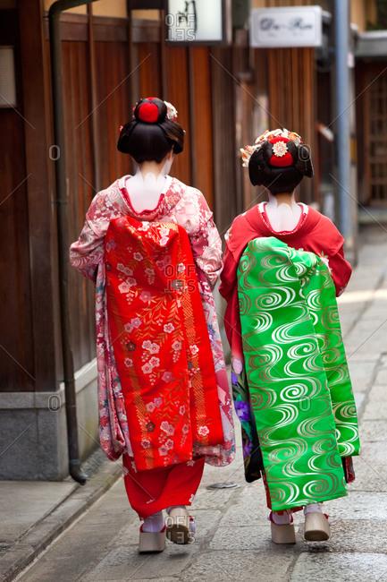 Back view of geisha wearing traditional kimono, Kyoto, Japan