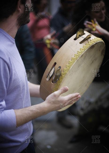Man playing the tambourine
