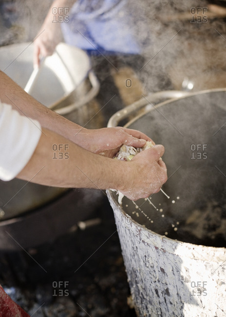 Chef crumbling ingredients out of a pot