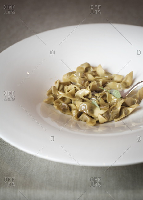 Traditional Italian tortellini with butter and sage