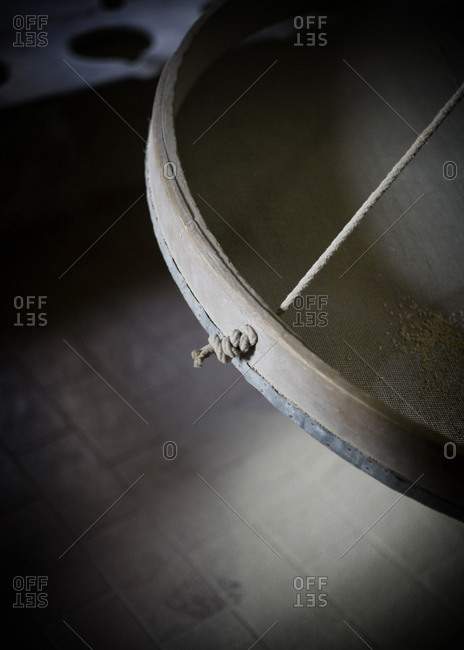 Close-up of sieve in mill