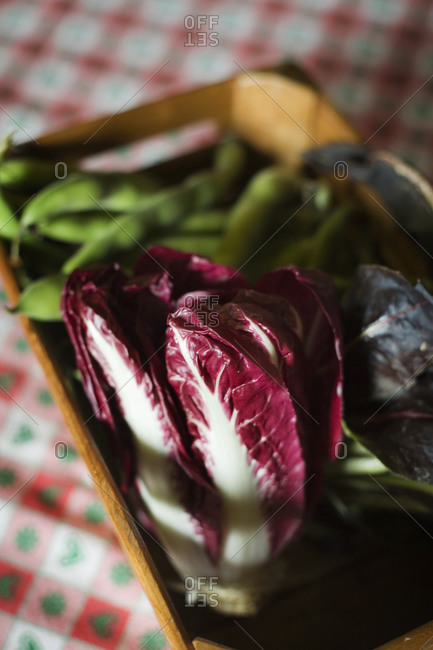 Crate of fresh vegetables with a radicchio in focus