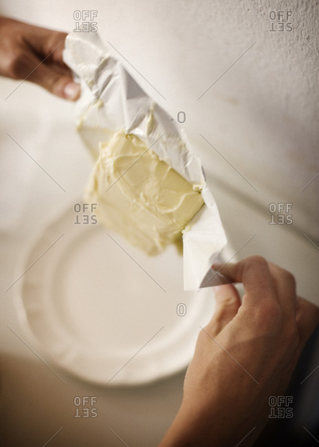 Chef unwrapping butter