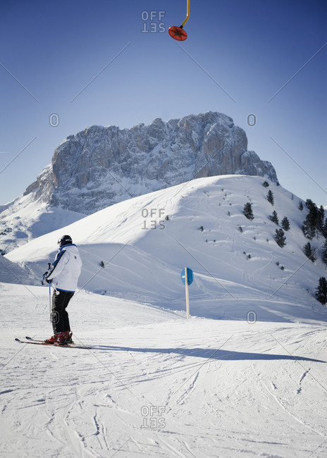 Skier standing on the slopes of Santa Cristina