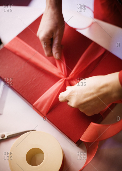 Man wrapping a present