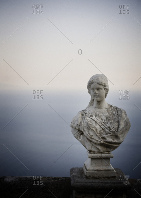 Female bust with the sea in the background