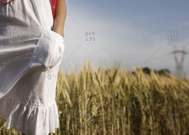 Low angle view of woman standing on field