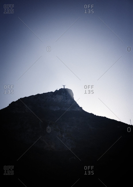 Silhouette of Christ of Maratea on peak, Italy