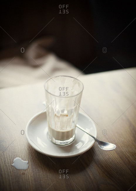 Overhead view of caffe latte on wooden table