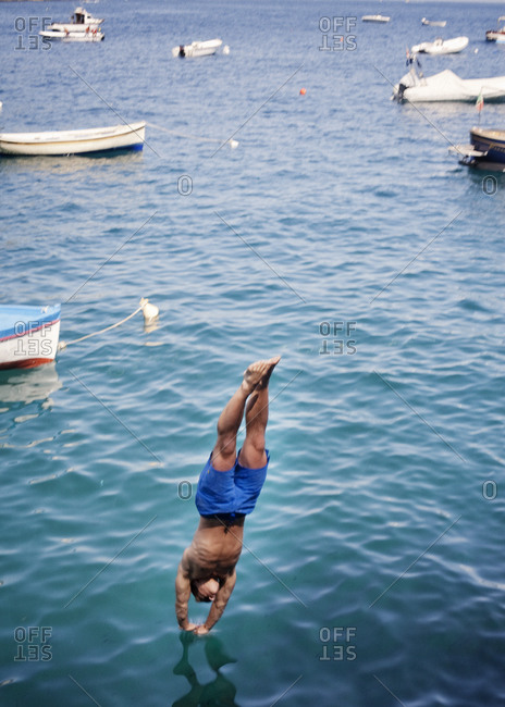 Athletic man diving into the sea