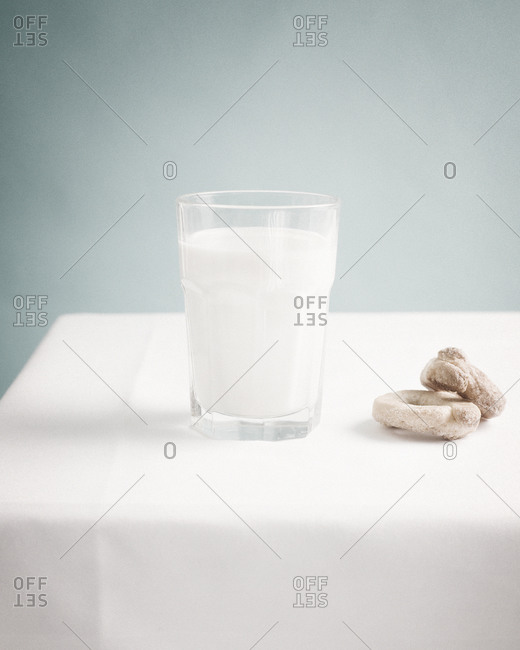 Still life of glass of milk and cookies