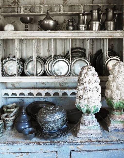 Antique cookware arranged in interior