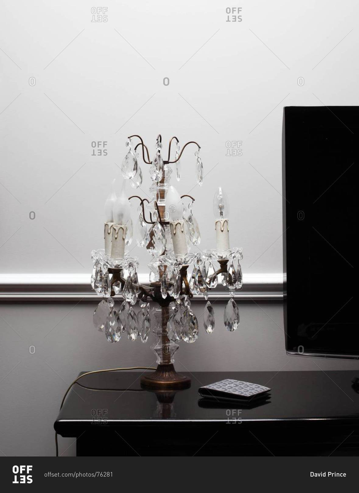 Crystal chandelier table lamp next to tv set stock photo for Table lamp next to tv