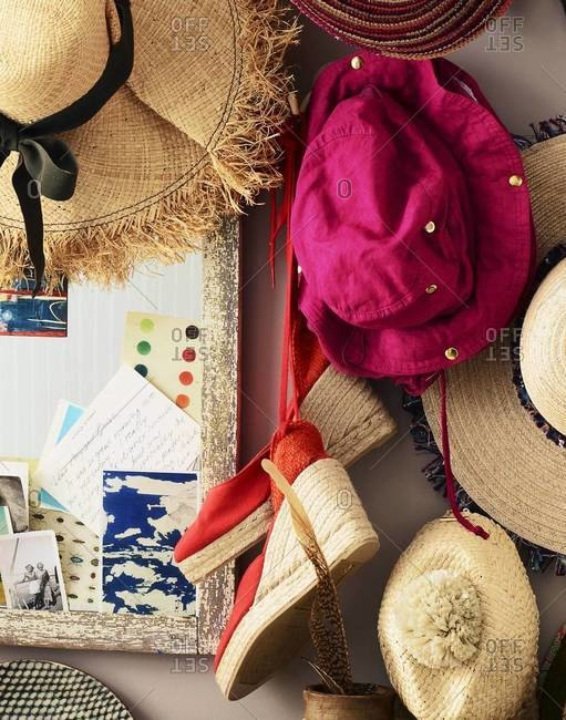 Straw hats hanging above a wooden table