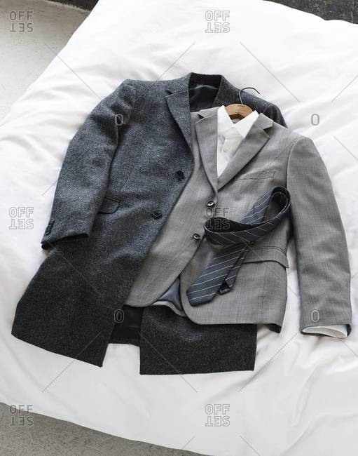 High angle view of formal clothing on bed