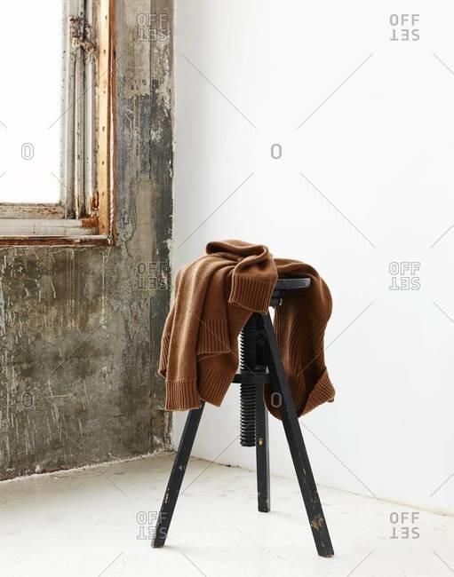 Swivel bar stool standing in room in front of window