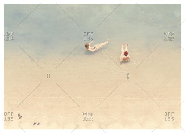 Two swimmers floating in the Arabian sea, Qatar