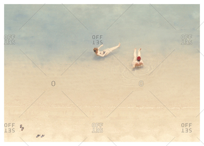 Two swimmers floating in the Arabian sea, Qatar