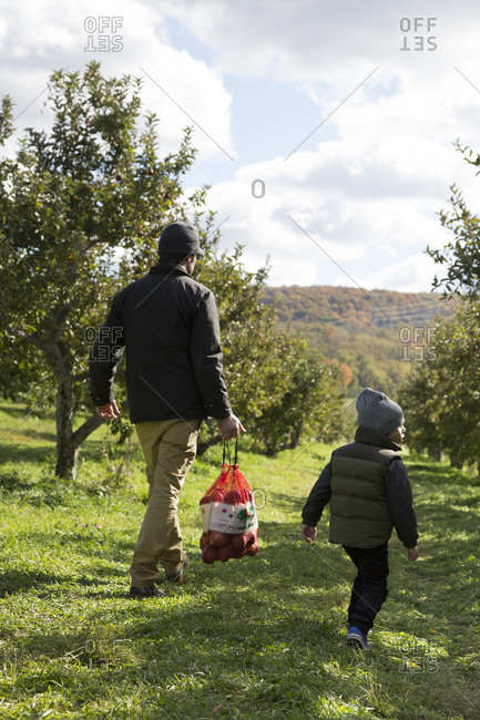 Father and son at the end of the day of apple picking