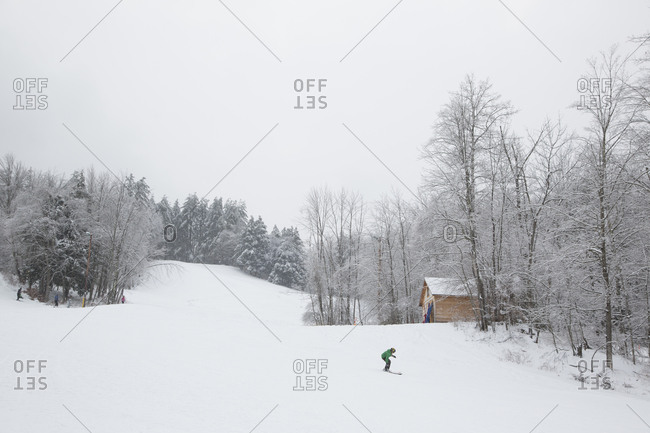 A person snowboarding down a slope