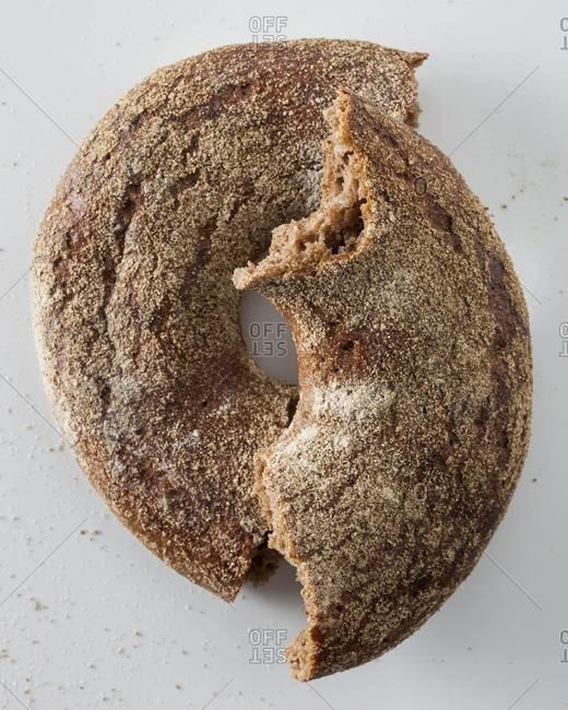 Whole-grain bagel broken in half