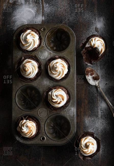 Chocolate cupcakes with toasted meringue frosting