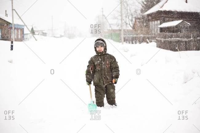 Asian boy walking in snow