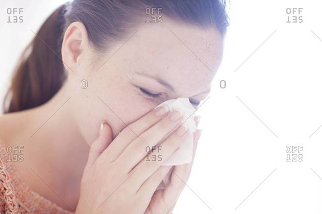 Young woman sneezing - Offset Collection