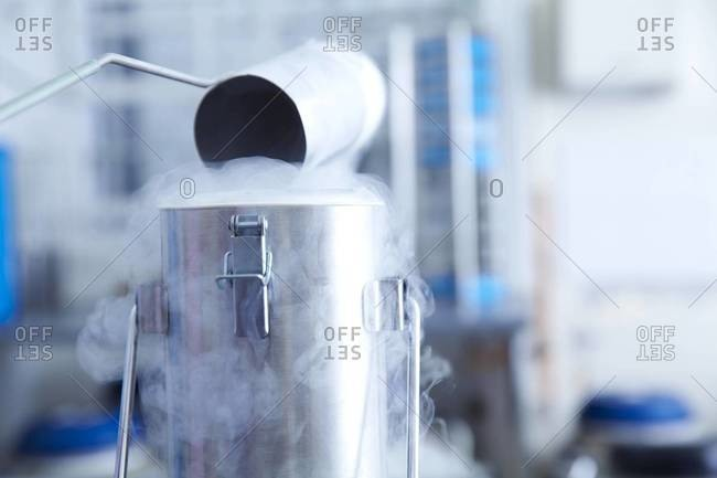 Cryostorage liquid nitrogen being poured into a canister