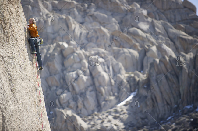 A man sport climbs in Bishop, California