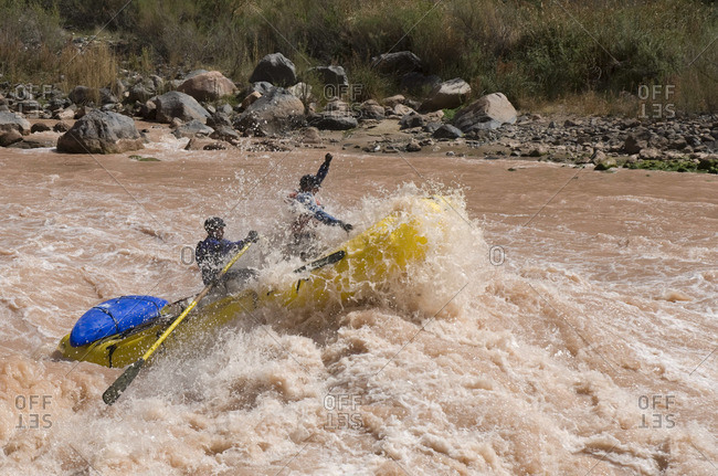 Rafters pushing through a big wave in Lava Falls rapid on the Colorado River