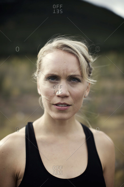 A young blond woman keeps fit by working out outside