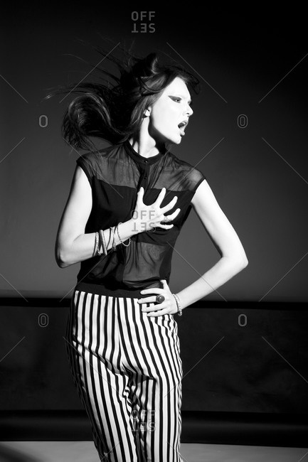 Screaming fashion model in move