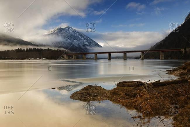 Bridge over frozen Sylvenstein Dam