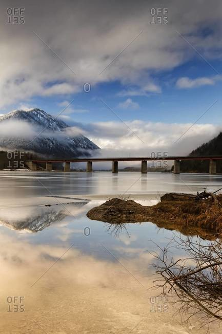 Bridge crossing over frozen Sylvenstein Dam