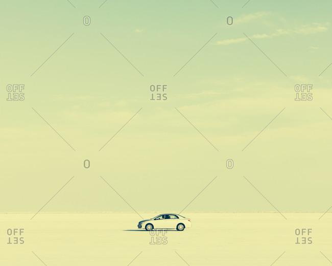 Side view of white car on the Bonneville Salt Flats, Utah